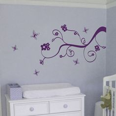 This is what is on Brylee's wall, except it is in light pink with darker pink walls.  I love the Dali decals.  It will be very easy to change out the decals as the kids get older.  Changing the pink paint... that may be harder  :/