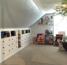 Built in dressers in attic space. Boys room with slanted ceilings