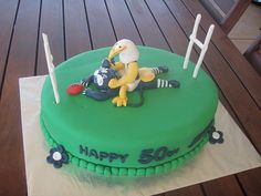 Mossy's masterpiece - West Coast Eagles mascot beating the cr*p out of the Geelong cats mascot cake by Mossy's Masterpiece cake/cupcake designs, via Flickr
