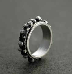 Meteorite Spinner Ring in Sustainable Sterling Silver - Handmade to Order. $79.00, via Etsy.