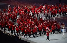 Canadian athletes enter the stadium lead by flag bearer Hayley Wickenheiser carrying the flag into the Opening Ceremony in Fisht Stadium at ...