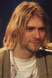 Kurt Cobain of Nirvana, Courtney Love of Hole, and Frances Bean Cobain | 19 Rock Star Kids Who Look Just Like Their Parents