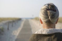Mature woman standing on boardwalk at beach