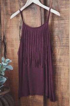 Fringe spaghetti strap tunic tank top 60% Cotton, 35% Polyester, 5% Spandex COLOR: BURGUNDY