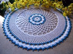 The fingers and hook have been FLYING! Here are the latest three...hope you like them... This doily is called Periwinkle. It was made w...