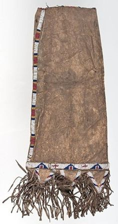 native american, America, Sioux [Native American Indian] beaded hide tobacco bag, sinew-sewn and beaded using colors of white, dark blue, greasy yellow, and red white-heart; single lane decorate throat of bag and continues to outline triangular tabs at bottom; tabs detailed with fringe, late 19th century.