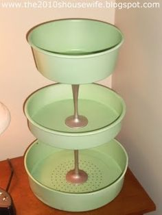 great spray painted cake pans with dollarstore candleticks by leanne