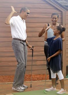 Barack Obama and his daughters.