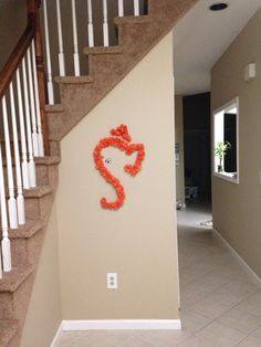 My simple Ganesha.  Orange  tissue paper flowers taped to wall with painters tape