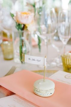 Blush Charleston Plantation Wedding Creative wedding escort card idea - macaroon escort card idea with flag name card dipped in gold glitter {Aaron and Jillian Photography} Wedding Reception Places, Wedding Place Settings, Reception Card, Wedding Seating, Table Place Settings, Creative Place Cards Wedding, Diy Place Cards, Wedding Cards, Wedding Place Card Holders