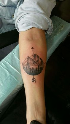 "Possible idea for camp tat. More sky and trees in place of mountains. Quote, like ""on my honor"" or ""on the loose"" or about pointing north around the base."