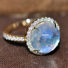 Now that's sweet. A solid 18k gold band boasts a 6.5ct rose-cut moonstone, known for its connection to feminine energy and insight. Encircled in sparkling white diamond pavé. Please contact info@norak