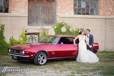 Bride and Groom with red sports car  www.facebook.com/JonathanIvyPhoto