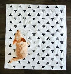 Dogs are the best helpers, right? ;) Minimal Triangles Quilt - http://suzyquilts.com/shop/minimal-triangles-quilt-pattern-download/