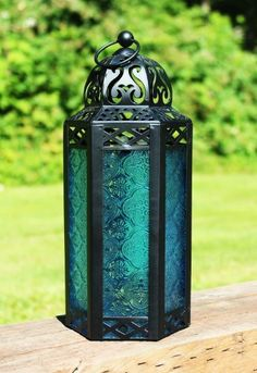 Mid Size Table/hanging Blue Hexagon Moroccan Candle Lantern Holders by GiftGuys, http://www.amazon.com/dp/B00B3L0550/ref=cm_sw_r_pi_dp_Li5msb0Q83YBE
