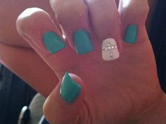 Love the white accent nail w/ the cross. It really POPS next to the teal/turquoise color.