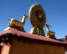 On the roof of the Jokhang Temple is a golden eight-spoked Dharma Wheel, flanked by two deer. The spokes of the wheel represent the Eight-fold Path (to enlightenment) and the deer serve as a reminder that Buddha gave his first sermon in a deer park.