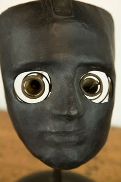 Whole Face Ophthamologic Medical Tool, American, 19th century.  Used by ophthalmology students to practice surgical skills. Two spring mounted brass eye holders would hold pig eyes for students to work on.