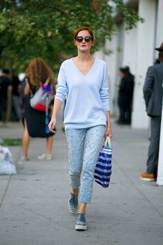 Icy pastels, like this baby blue, look light. Plus, the thin weave and wide V-neck feel easy-breezy (as far as sweaters go).