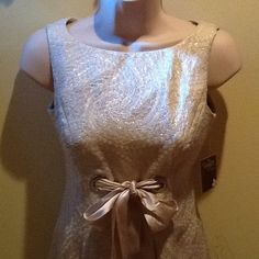 💥NWT💥 Never Worn! Elegant Sleeveless Dress Rebecca Taylor Dress with Bateau Neckline Metallic Brocade Dress with Bow Tie Belt (Petite). Go to this website for details on the dress and for sizing measurements.  http://foreverelegant.com/taylor-dresses-2631p-bateau-neckline-metallic-brocade-dress-with-bow-tie-belt-petite.html.  Bought it for a wedding, but it doesn't fit. So bummed! Rebecca Taylor Dresses