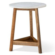 The Lanham Marble Top Side Table from Threshold has a beautiful blend of mango wood and marble. The accent table has a tripod wooden base with a shelf supported near the bottom. The marble top is a half inch thick and 16 inches wide in cool white tones. The side table can work in a living room beside a chair or couch or even in the kitchen as a plant stand.