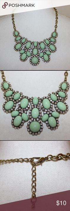"""Trendy Statement Necklace The green color in this necklace is the perfect color for spring! It is made of green ovals surrounded by crystals, and is gold plated. It measures 18"""" to 22"""", but you can really use any of the links to make it any size you want. It is in perfect condition - no flaws:) Jewelry Necklaces"""