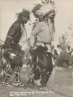 circa 1900 Two unidentified Sioux men wearing headdresses, bells, and feather bustles dance at the Fort Yates Fair. Others in background . Native American Images, Native American Artwork, Native American Tribes, Native American History, Native Americans, American Symbols, African Americans, American Women, Eskimo