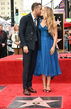 Sweet smooch: Ryan Reynolds and Blake Lively pose for a photo as Ryan Reynolds is honored with star on the Hollywood Walk of Fame on December 15 2016
