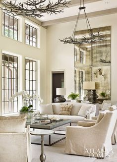 Cream, antiqued mirrors, metal tables, windows, branches, deer, orchid