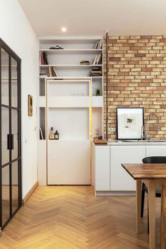 A bookshelf slides back to reveal a secret workspace inside this apartment in Berlin. Brew Box Pad/ Itay Friedman