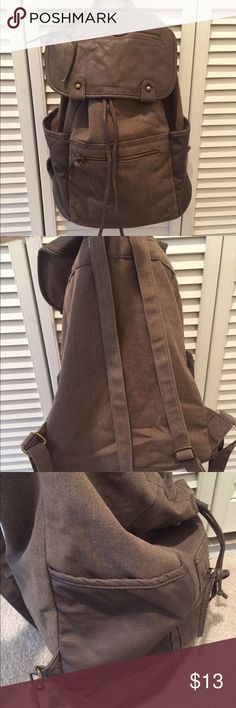 Taupe Backpack Cute taupe large backpack, adjustable straps, side pockets and front zip pockets give you plenty of extra space and easy access to your things. Gently used. However there is 1 mark on front of Bag as pictured. Otherwise still in good shape. Bags Backpacks