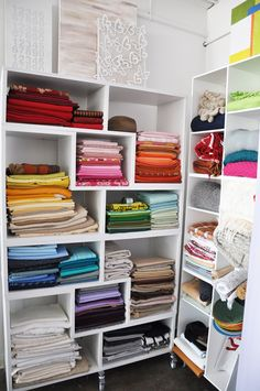 Check out this fabric/blanket storage!