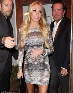 Glowing: Petra Ecclestone held a protective hand over her round tummy after enjoying dinner with her husband James Stunt at Madeo's restaurant in LA