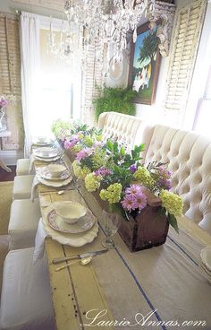 LaurieAnna's Vintage Home  dining room with 8ft. tool box on 10 ft. table with 48 mason jars inside with flowers