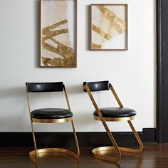 Farrah Dining Chair   Clean lines and luxe materials make the Farrah Dining Chair a striking update to any dining room. Inspired by 70's décor, the simple silhouette feels at once glamorous and easy. We paired the antique gold cantilevered base with a rounded seat and back upholstered in rich ink faux leather.