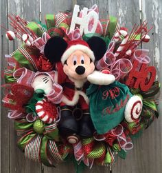 Mickey Mouse Christmas Wreath, Disney Christmas Wreath, Christmas Wreath, Holiday Wreath, A Magical Happy Holiday, Mickey Christmas by BaBamWreaths on Etsy https://www.etsy.com/listing/210781447/mickey-mouse-christmas-wreath-disney