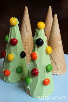 Upside-down ice cream cones as Christmas trees. What a neat thing for little kids to create!