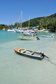Boats lined up in La Digue's Harbor, Seychelles Islands