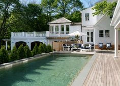 pool, and the porch over the arched garage doors. what a great layout!