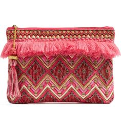 Loving this bohemian chic clutch that is beaded and trimmed in pink fringe.