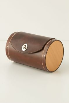 Leather & Cedar Bicycle Trunk - Anthropologie.com | Oregon-based founder of Walnut Studiolo Geoffrey Franklin fuses function with aesthetic to produce durable, innovative bike accessories. Peddle the path less taken with this tanned, waterproofed leather bike trunk encased in cedar wood, inspired by the design of antique steamer trunks and St. Bernard barrels. The trunk securely fastens to any seat rail with leather straps.