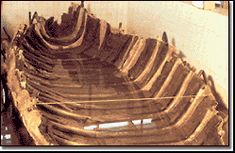 Biblical archaeology - The hull of a fishing boat from the first century CE was recovered from the mud along the receding shoreline of the Sea of Galilee.