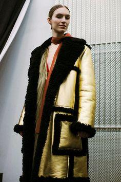 Oversized gold and black shearling coat backstage at Prada AW14 MFW. More images here: http://www.dazeddigital.com/fashion/article/18963/1/prada-aw14