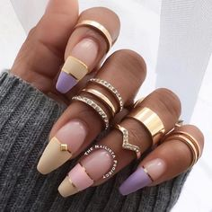 Nails with gold jewellery to supplement pattern.