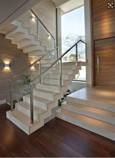 #modern #home #staircase #glassrails #living #space #moodlight #darkwoodfloor #interiors #interiordesign #design