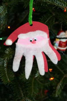 Google Image Result for http://www.holiday-kids-crafts.com/image-files/SantaHandprintOrnament.jpg