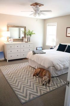 Ten June: Our Rental House: A Master Bedroom Tour (I like the rug placement -- it's from Pottery Barn)m- green plants
