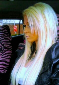 Light blonde hair with light pink highlights