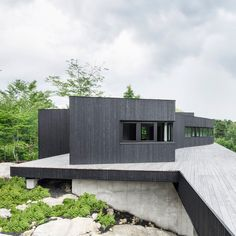 Canadian firm Alain Carle Architects has built a sustainable house in the mountains of Quebec as a retreat from modern conveniences.