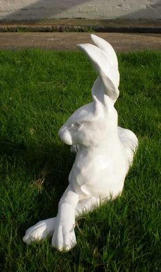 Cast marble resin Garden Or Yard / Outside and Outdoor sculpture by artist Christine Close titled: 'Hare Line (marble resin Big Fun Hare Lying Alert sculptures statues)'